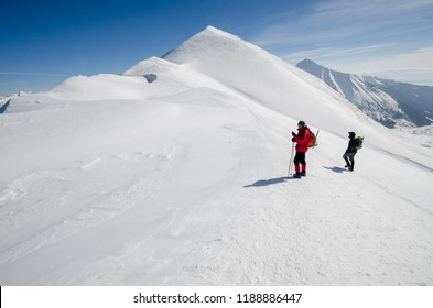 TATRY MOUNTAINS, POLAND - MARCH 4, 2017 : People hiking in beautiful winter  Polish Western Tatra mountains .