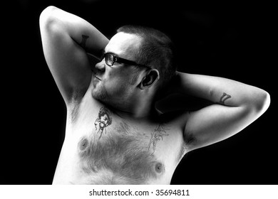 Tattoed biker shows you his muscle