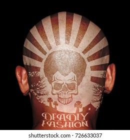 Tattoo of an Afro skull with the word: Deadly Fashion on the back of a skinhead head.