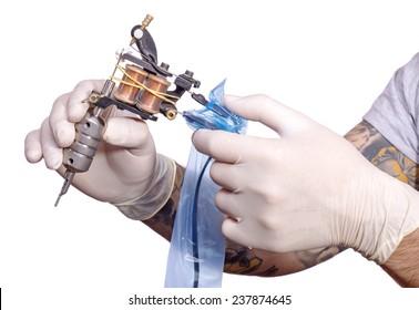 Tattoo artist preparing for work