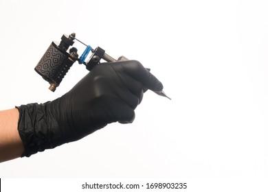 tattoo black machine macro shot in hands photo