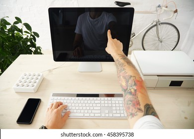 Tattooed hands uses touch screen One finger click gesture Working at home office