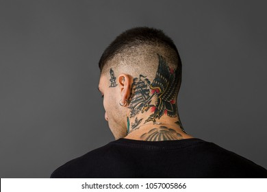 Tattooed man back portrait - Eagle, ship, swallow and dagger tattoos