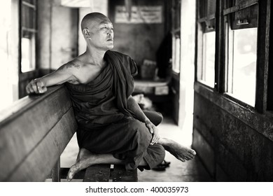 TAUNGGYI - MYANMAR - NOVEMBER 23, 2015: Unidentified Buddhist monk on November 23, 2015 in Taunggyi, Myanmar. Burma is one of the most devout Buddhist countries in the world
