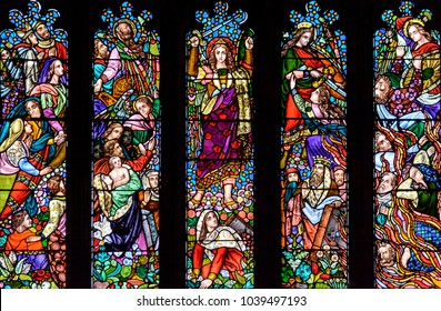 Taunton, England - Feb 22, 2018: Bottom Panel of West Stained Glass Window in St Mary Magdalene Church