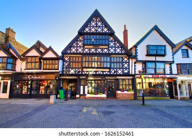 Taunton, UK - December 25, 2019: The Tudor Tavern in Fore Street, Taunton, Somerset, England has been designated as a Grade I listed building. Built in 1578, now it hosts a Caffè Nero coffee house