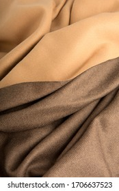 Taupe and tan coloured fabric draped in loose waves