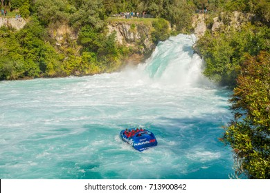 Taupo, New Zealand - April 26 2017: Tourist adventure in Huka Falls with Huka jet boat the most famous iconic thriller activity in Taupo, New Zealand.
