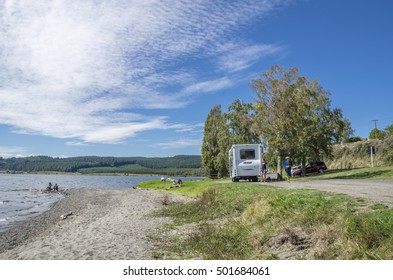 Taupo, New Zealand - March 27,2016 : Trailer caravan in Lake Taupo,New Zealand. People can seen exploring around it.