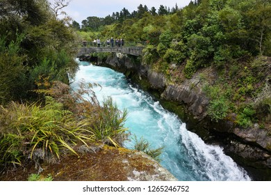 Taupo, North Island, New Zealand, December 6, 2018. Lush Landscape with Tourists standing on a Bridge over the Waikato River at Huka Falls