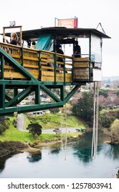 TAUPO, NZ - SEP 13 2014:Person during bungy jump from 47 metres in above the Waikato River in Taupo, New Zealand.