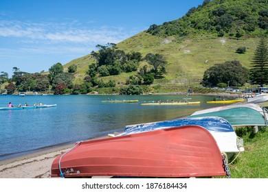 Tauranga New Zealand - December 2 2020; Upturned dinghies and waka-ama being paddled across Pilot Bay