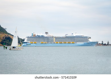 TAURANGA, NEW ZEALAND - DECEMBER 26, 2016: The mighty Ovation of the Seas Cruise Ship by Royal Caribbean International enters Tauranga Harbour for the first time. Mount Maunganui in the background.