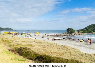 TAURANGA NEW ZEALAND- FEBRUARY 9; Contestants and organizer get ready for the Generation Homes Sand to Surf swim event on overcast day February 9 2019 Tauranga New Zealand