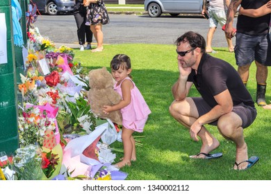 Tauranga / New Zealand - March 16 2019: A Little Girl Placing a Teddy Bear With the Floral Tributes at Tauranga Mosque, in the Aftermath of the March 15 Mosque Attacks in Christchurch