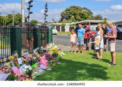 Tauranga / New Zealand - March 16 2019: Families Look at Floral Tributes Laid Outside Tauranga Mosque, in the Wake of the March 16 Mosque Attacks in Christchurch
