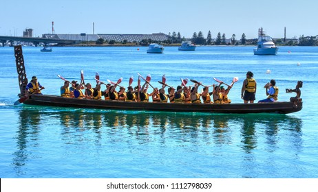 Tauranga / New Zealand - October 23 2010: A Large Waka (an Ornately Carved Maori Ceremonial Canoe) on the Waters of Tauranga Harbor