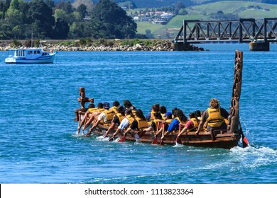 Tauranga / New Zealand - October 23 2010: A Richly Carved Maori Canoe (Waka) With Many Paddlers on Tauranga Harbor