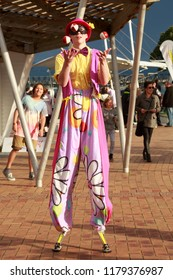 Tauranga / New Zealand - September 21 2014: A Stilt Walker With Baggy Clown Pants Juggling Three Balls