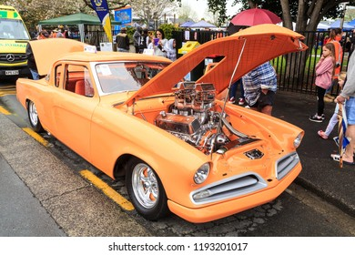 Tauranga / New Zealand - September 22 2018: A Bright Orange, Heavily Modified 1955 Studebaker, With the Hood Open to Show Off a Shiny High-Performance Engine. Seen at an Outdoor Car Show