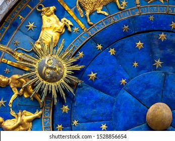 Taurus astrological sign on ancient clock. Detail of Zodiac wheel with Sun and Taurus. Golden symbol of bull on star circle closeup. Concept of astrology and horoscope.