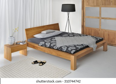 Taurus bed with tilted headboard.