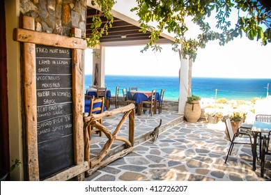 A Taverna in Ios, Greece with the chalk menu-board outside.