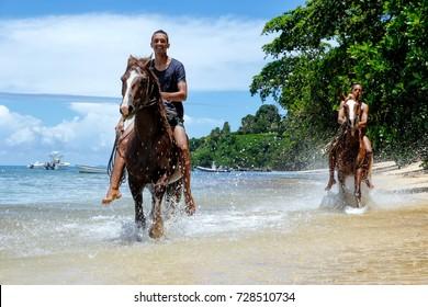 TAVEUNI, FIJI - NOVEMBER 23: Unidentified man rides a horse on the beach on November 23, 2013 on Teveuni island, Fiji. Taveuni is the third largest island in Fiji.