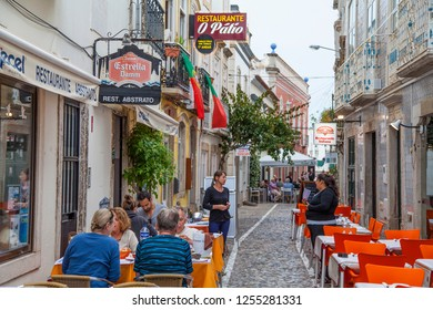 Tavira, Algarve / Portugal - 06/03/2018: people on the street of the historic center of Tavira, city founded in 1266, Algarve, south Portugal