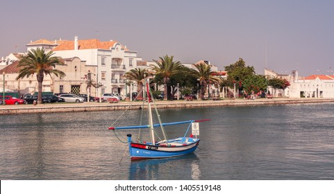 Tavira, Algarve, Portugal - August 21, 2013: Small blue boat on one of the channels of the maritime port of Tavira, in southern Portugal