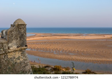 TAVIRA, PORTUGAL - AUGUST 23, 2018: People at the famous beach of Cacela Velha in Tavira. This beach is a part of famous tourist region of Algarve.