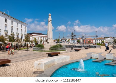 TAVIRA, PORTUGAL - AUGUST 30, 2017: View of fountain and War memorial in Republic Square. Algarve