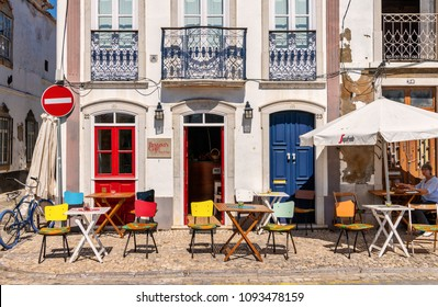 Tavira, Portugal. Circa March 2018. View of sidewalk cafe in the picturesque village of Tavira, Portugal.