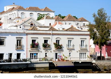 TAVIRA, PORTUGAL - JUNE 12, 2017 - Waterfront townhouses along the riverbank of the Gilao river with steps leading to the water, Tavira, Algarve, Portugal, Europe, June 12, 2017.