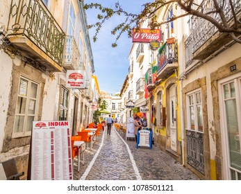 TAVIRA, PORTUGAL -MARCH 28, 2018:  Small street in the old town of Tavira in Algarve region, south of Portugal.