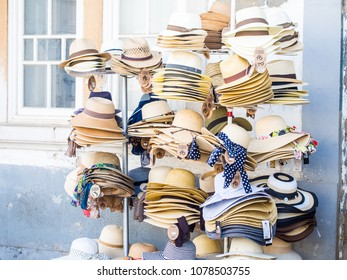 TAVIRA, PORTUGAL - MARCH 28, 2018: Stand selling hats in the Old Town of Tavira, Algarve region in the south of Portugal.