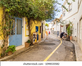 TAVIRA, PORTUGAL - MARCH 28, 2018:  One of the small streets in the historical part of Tavira in Algarve region, south of Portugal. Wide angle.
