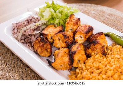 Tavuk sis, Turkish chicken stick shish traditional kebab with lettuce and onion