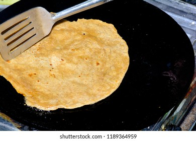 Tawa Paratha also known as plain parathas are Indian flatbread that are crisper and flakier version of phulka's and are traditionally cooked in ghee on an iron skillet . Fulka, Paratha, Indian Bread,