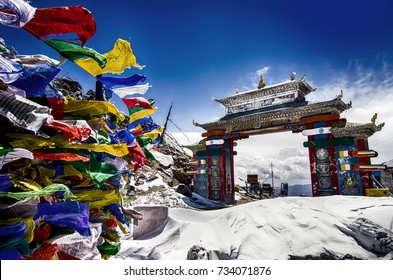 Tawang, Arunachal Pradesh, India.  The Buddhist architecture, prayer flags and full of snow on a misty morning at Tawang, Arunachal Pradesh, North East India.
