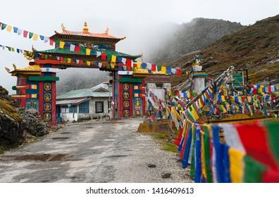 Tawang, Arunachal Pradesh, India. The colourful gateway entrance through Sela Pass on a misty moring in the Himalayas between Dirang and Tawang, Arunachal Pradesh, India.