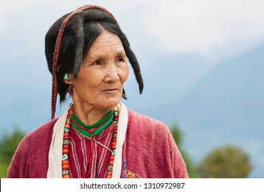 TAWANG, INDIA - SEPTEMBER 21, 2011: Woman of the Monpa tribe wearing traditional clothes and Yak hair hat at the Buddhist Monastery on September 22, 2011 at Tawang, Arunachal Pradesh, India.