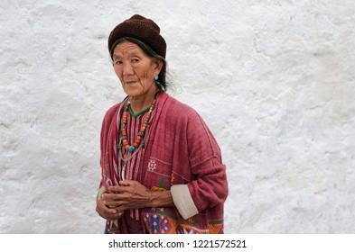 TAWANG, INDIA - SEPTEMBER 22, 2011: Woman of the Monpa tribe at Buddhist festival in traditional clothes at the Buddhist Monastery on September 22, 2011 at Tawang, Arunachal Pradesh, India.
