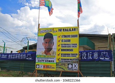 Tawau, Sabah - April 26, 2013: A poster of candidates with political flags and banners for the Malaysian 13th general election in Malaysia.