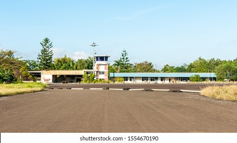Tawau, Sabah, Malaysia - 13 November 2011: Control tower and terminal of the old Tawau International Airport, closed down since 2001 and now in a state of decay.