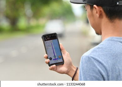 TAWAU SABAH MALAYSIA - July 12, 2018 : A man is using GPS application. Waze is one of the most popular GPS applications.