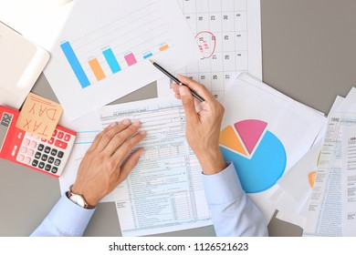Tax accountant working with documents at table