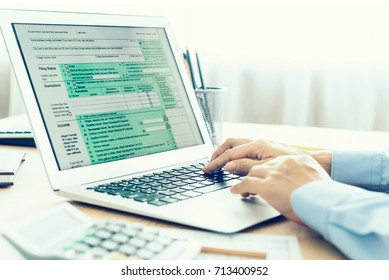 Tax concept, accountants are filling online tax information using laptops.