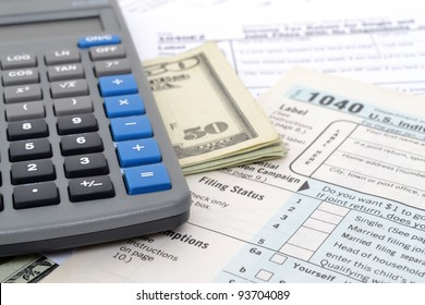 tax concept money forms and calculator