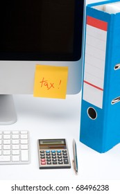 Tax concept - sticky notes with word tax, part of computer, keyboard, calculator, office folder and pen